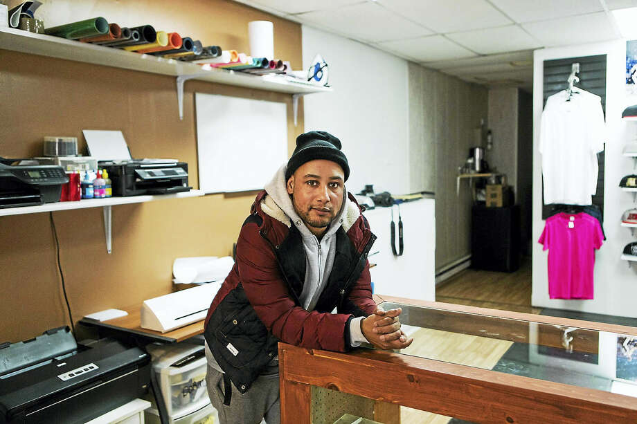 EG Photo Studio owner Eric Garcia in his storefront on Wyoming Street, a Hazleton, Pa., street that has been revitalized by Hispanic-owned businesses. Photo: Amanda Mustard — For The Washington Post    / For The Washington Post