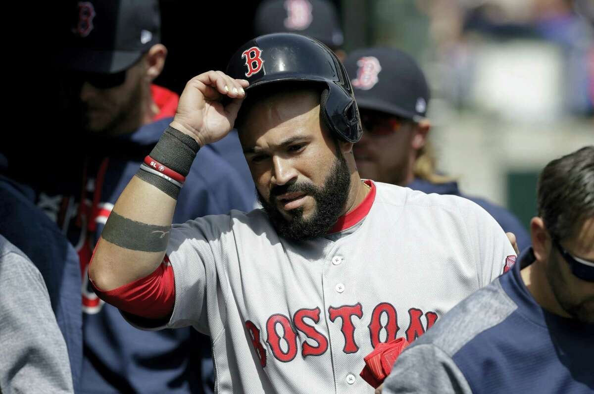 Boston Red Sox's Sandy Leon enters the dugout after scoring from third on a single by Marco Hernandez during the second inning of a baseball game against the Detroit Tigers on April 9, 2017 in Detroit.