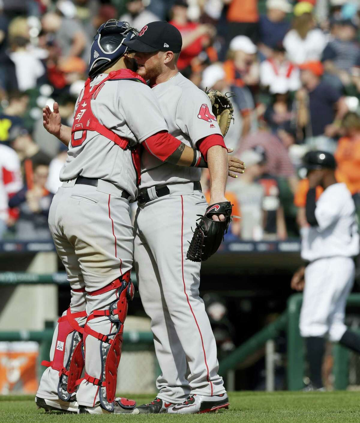 Boston Red Sox relief pitcher Craig Kimbrel is hugged by catcher Sandy Leon after the team's 7-5 win over the Detroit Tigers in a baseball game on April 9, 2017 in Detroit.