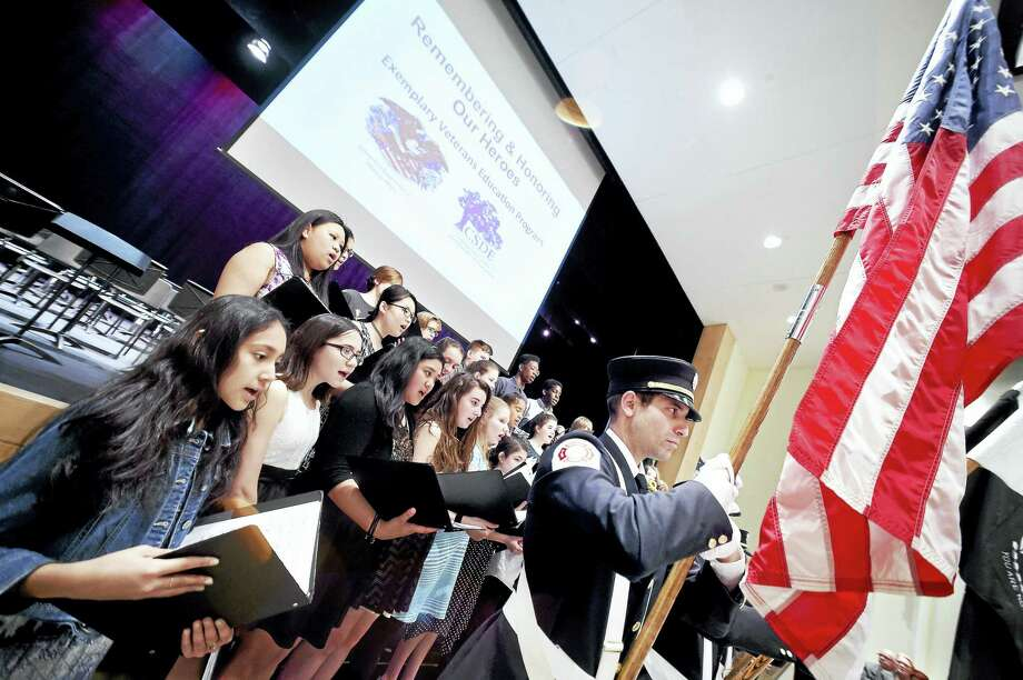 The Hamden Middle School Chamber Choir sings the national anthem during the Exemplary Veterans Education Program ceremony at Hamden Middle School Tuesday. Photo: Arnold Gold — New Haven Register