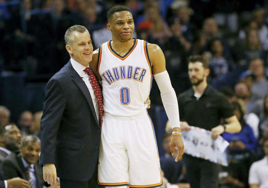 Oklahoma City Thunder guard Russell Westbrook (0) is hugged by head coach Billy Donovan after tying the record for triple-doubles in a season in the third quarter of an NBA basketball game against the Milwaukee Bucks in Oklahoma City on April 4, 2017. Photo: AP Photo — Sue Ogrocki   / AP2017
