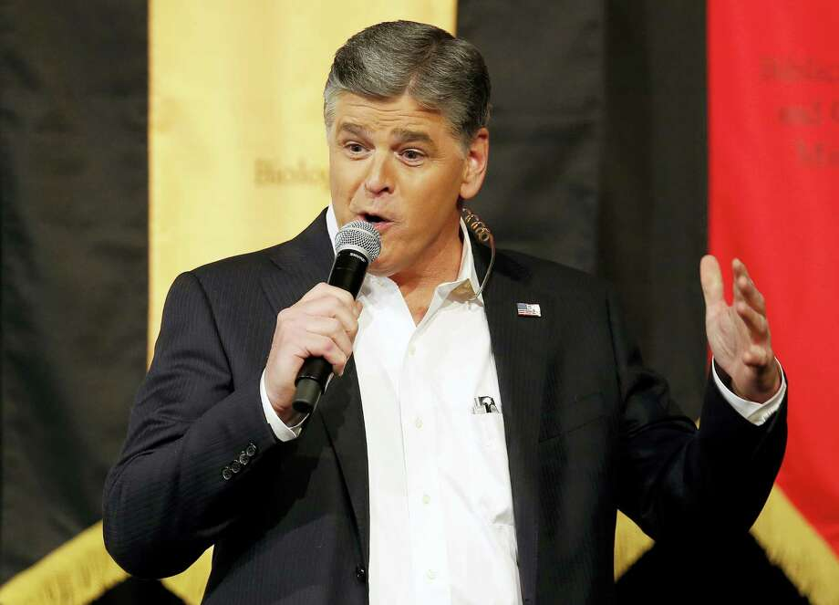 In this March 18, 2016, file photo, Fox News Channel's Sean Hannity speaks during a campaign rally for Republican presidential candidate, Sen. Ted Cruz, R-Texas, in Phoenix. Hannity denied a CNN report on March 16, 2017, that he pointed a gun at Fox News colleague Juan Williams on the network's set following an on-air argument between the pair. Photo: AP Photo/Rick Scuteri, File    / FR157181 AP