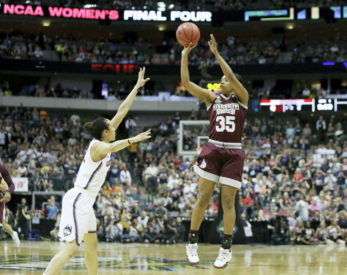 Mississippi State forward Victoria Vivians shoots over Connecticut guard Saniya Chong during the first half of the semifinals of the women's Final Four. Chong is excpected to be selected in Thursday's WNBA Draft,