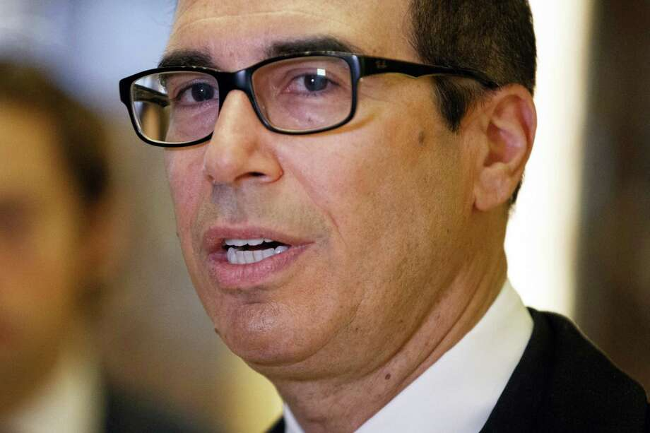 Treasury Secretary  Steven Mnuchin talks with reporters in the lobby of Trump Tower, Wednesday, Nov. 30, 2016, in New York. Photo: AP Photo/Evan Vucci / Copyright 2016 The Associated Press. All rights reserved.