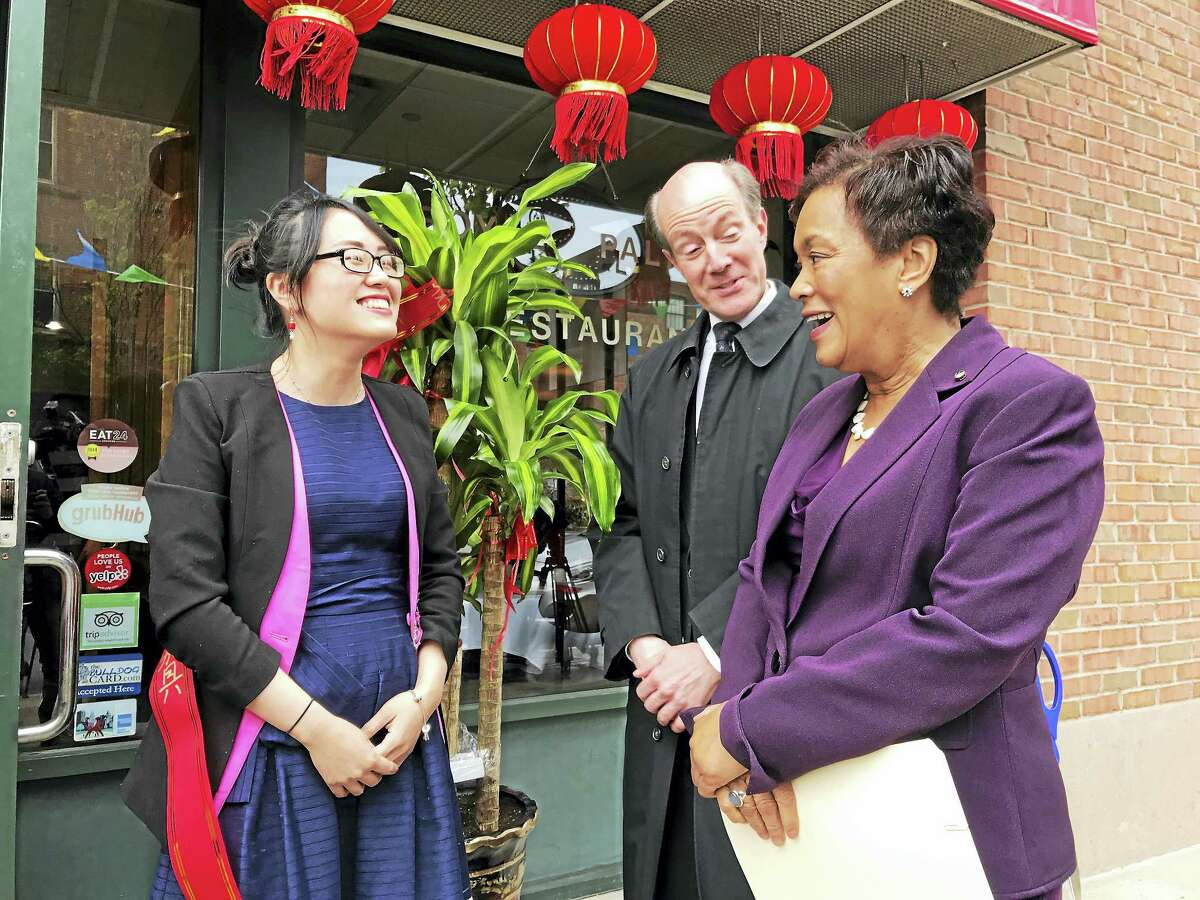 From left, Hunan House operator Emma Liu, city Deputy Economic Development Director Steve Fontana and New Haven Mayor Toni Harp chat before the grand opening of Hunan House Monday in New Haven.
