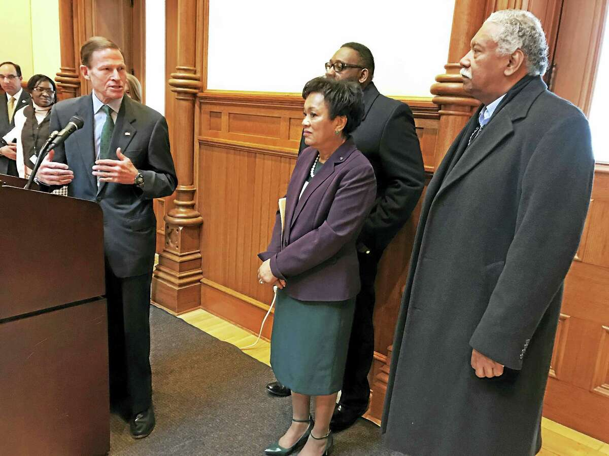 U.S. Sen. Richard Blumenthal speaks at City Hall while New Haven Mayor Toni Harp and City Alders Brian Wingate,D-29, (left) and Gerald Antunes, D-12, look on during a press conference on President Trump's proposed budget on Friday.