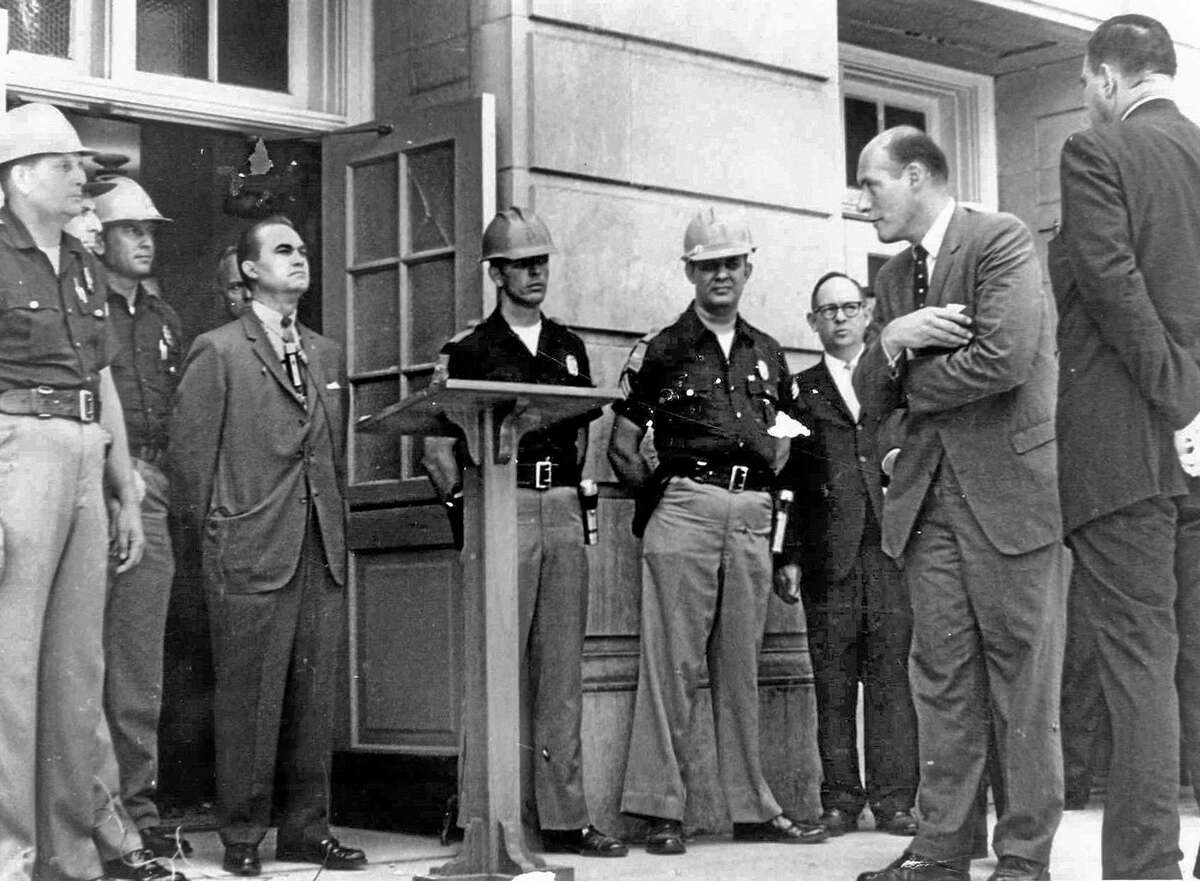 U.S. Deputy Attorney General Nicholas Katzenbach, second right, confronts Alabama Gov. George C. Wallace, standing in front of a door to keep blacks from enrolling at the University of Alabama in Tuscaloosa, Ala.