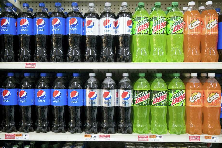 Sugar tax stickers are posted by sweetened beverages at the IGA supermarket in the Port Richmond neighborhood of Philadelphia after a new tax on sweetened drinks went into effect there. Photo: AP File Photo   / Copyright 2017 The Associated Press. All rights reserved.