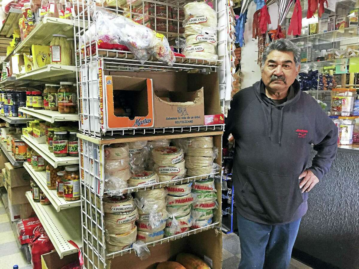 Nicolas Gutierrez stands inside Mexican Grand Deli, where he works along with his son, Thursday in New Haven. Gutierrez closed his business in solidarity with Day Without Immigrants.