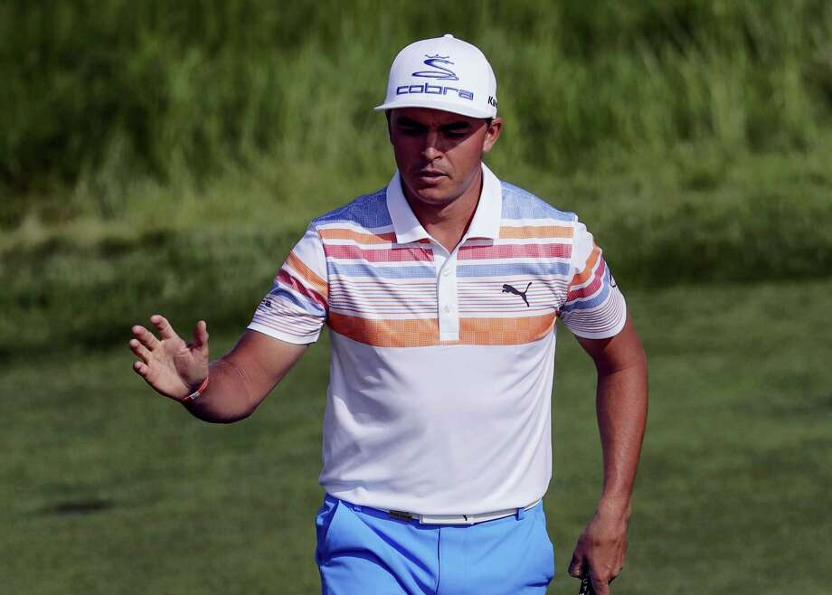 Rickie Fowler reacts after his birdie on the12th hole during the first round of the U.S. Open golf tournament Thursday at Erin Hills in Erin, Wis. Photo: David J. Phillip — The Associated Press   / Copyright 2017 The Associated Press. All rights reserved.