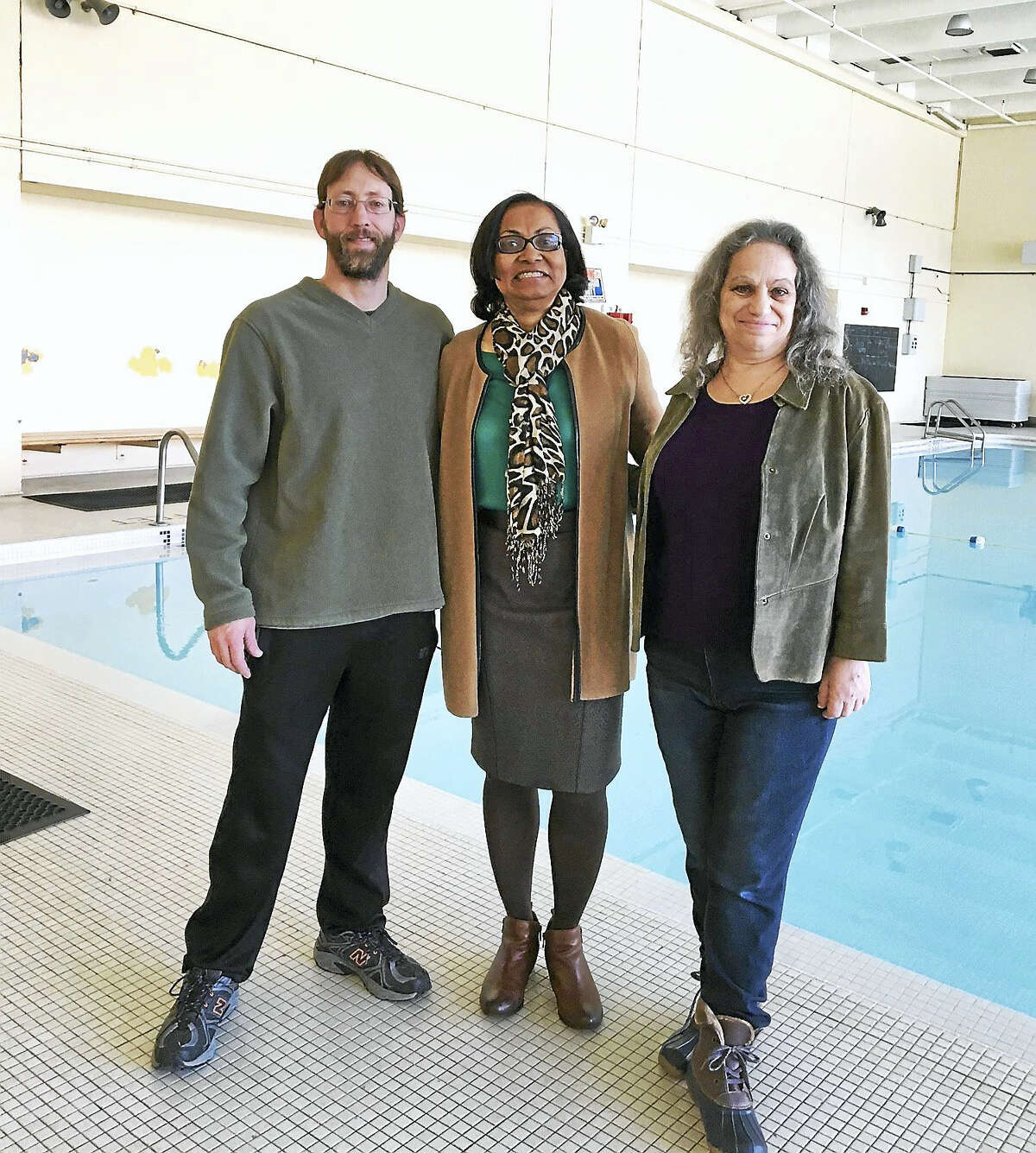 From left, Kacey Rosenfield, aquatic instructor at Conte-West Magnet School; Principal Dianne Spence and neighbor Heidi Korrick at the pool which will be opened to the public in a short trial run.