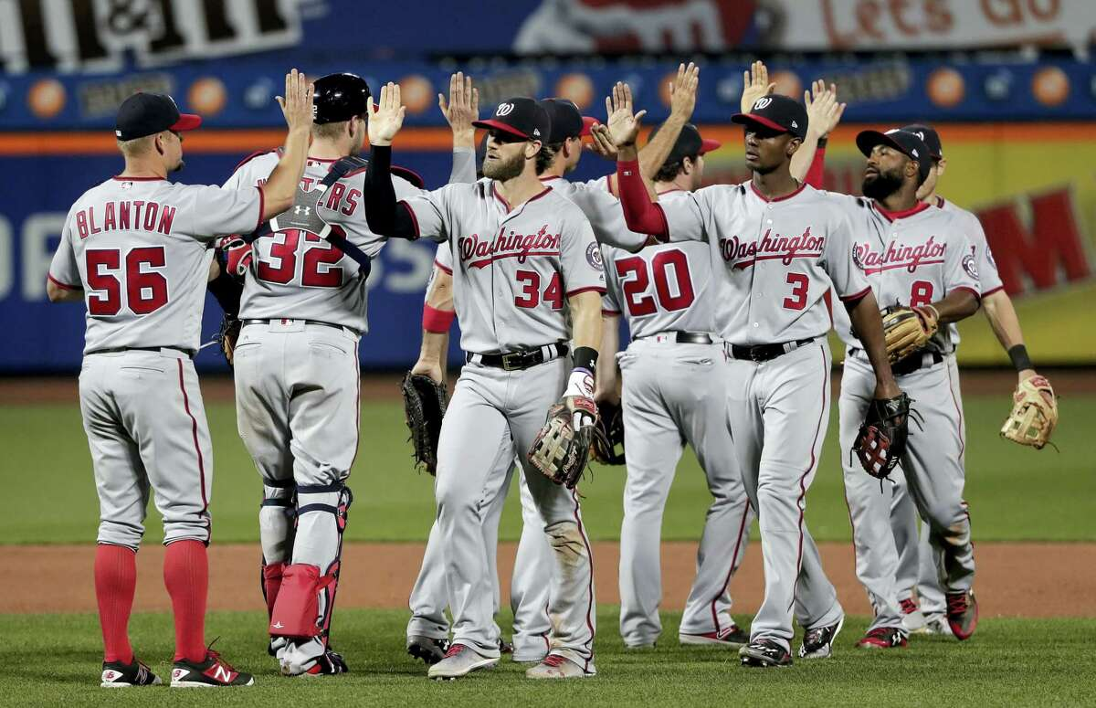 The Nationals celebrate after beating the Mets on Thursday.