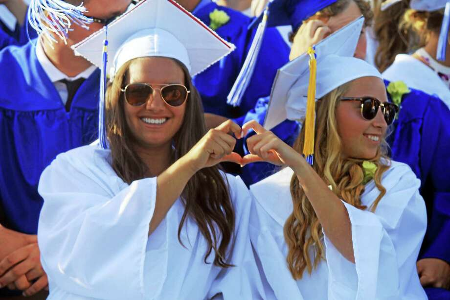 Students create symbolic hearts at Old Saybrook High School's graduation Wednesday at the encouragement of retiring teacher Gary St. Germain. Photo: Valerie Bannister