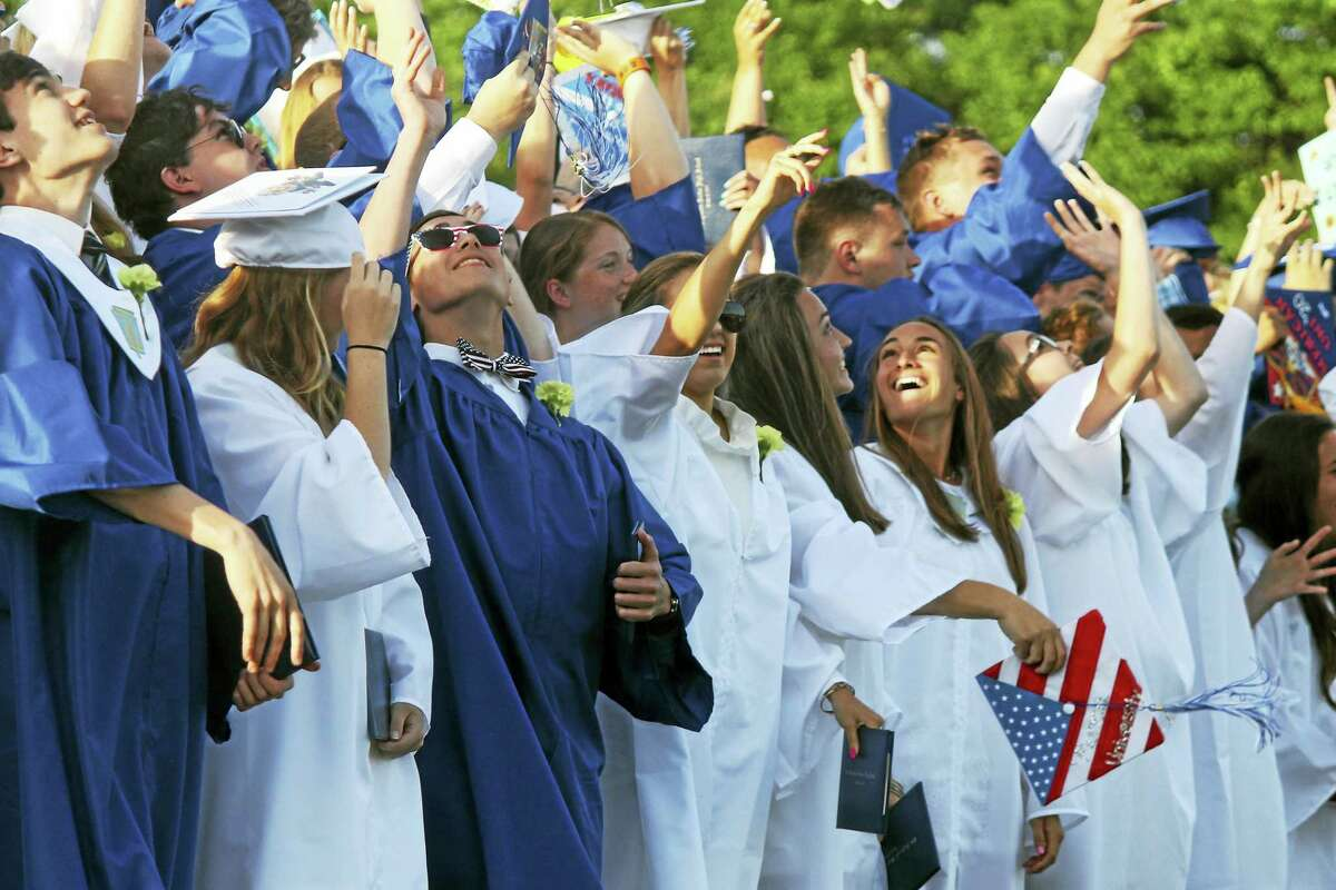Old Saybrook high School students send their caps skyward after being officially pronounced graduates Wednesday.
