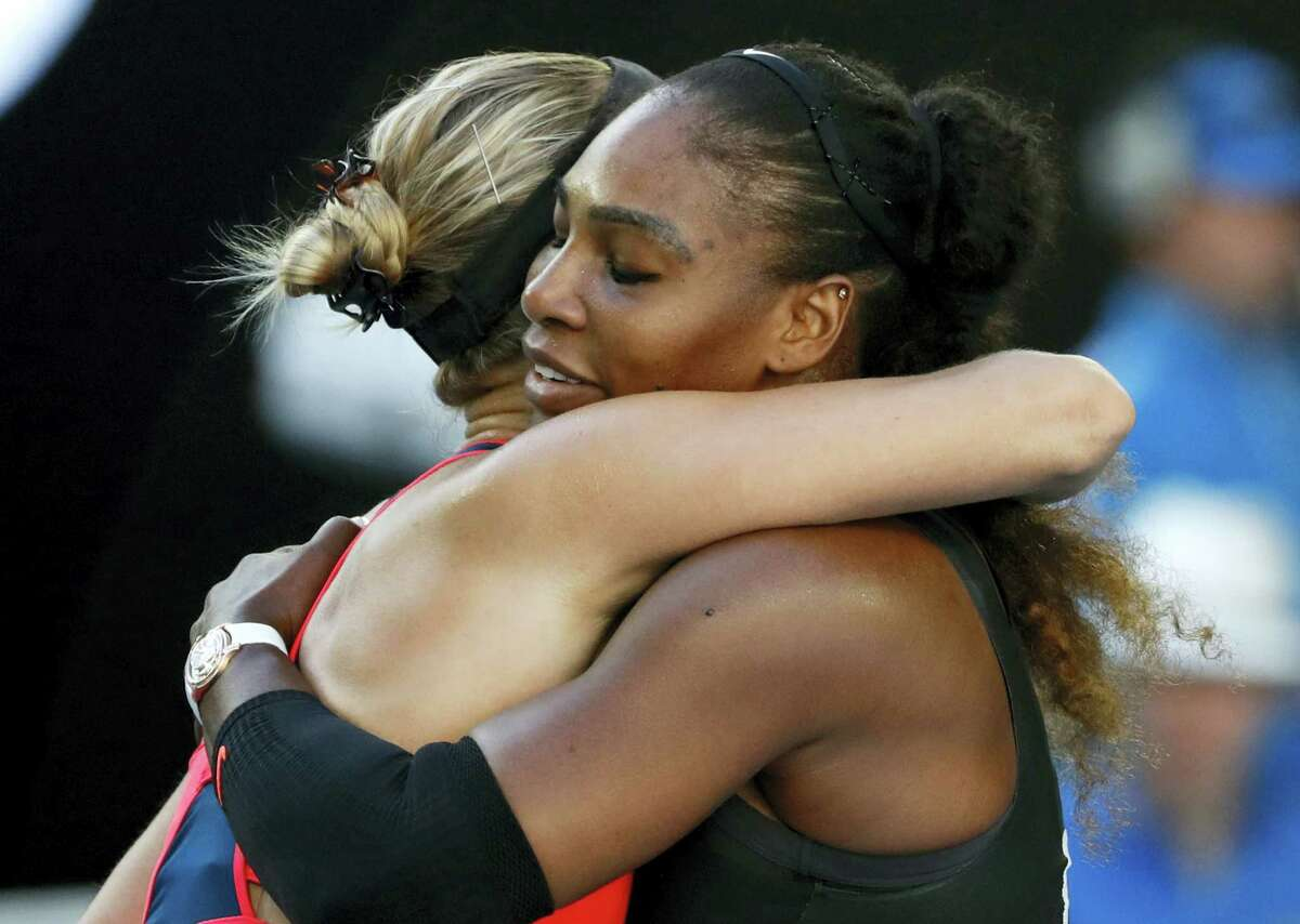 United States' Serena Williams, right, embraces Croatia's Mirjana Lucic-Baroni, after winning their semifinal at the Australian Open tennis championships in Melbourne, Australia on Jan. 26, 2017.