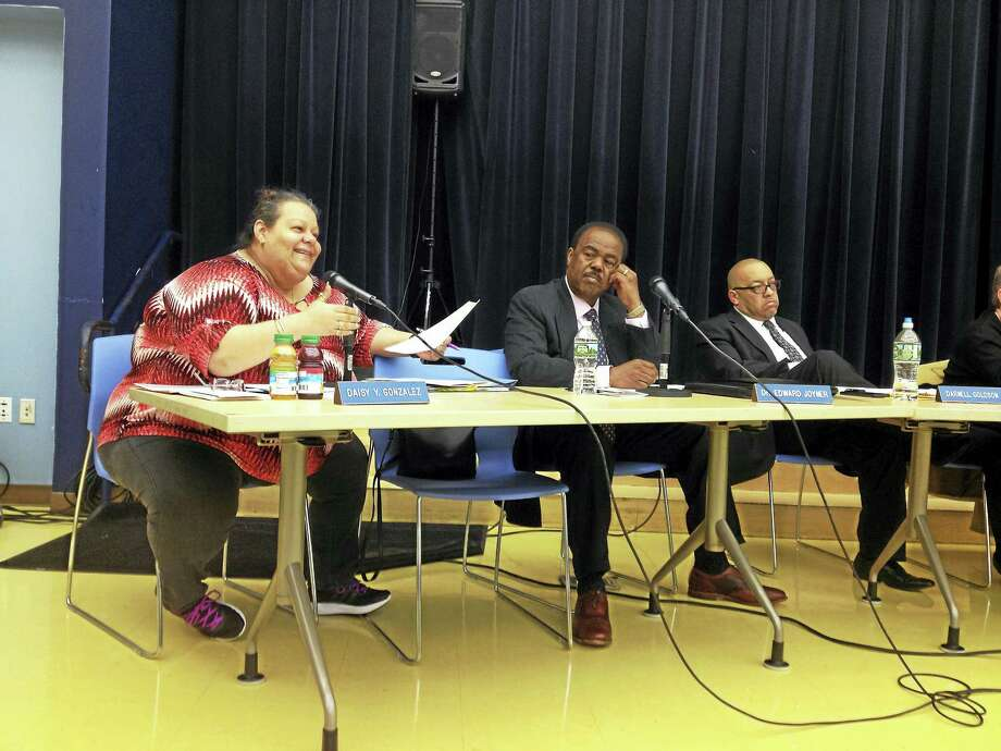 BRIAN ZAHN — NEW HAVEN REGISTER  Board of Education members, from left, Daisy Gonzalez, Ed Joyner and Darnell Goldson at a meeting Monday in New Haven. Photo: Digital First Media