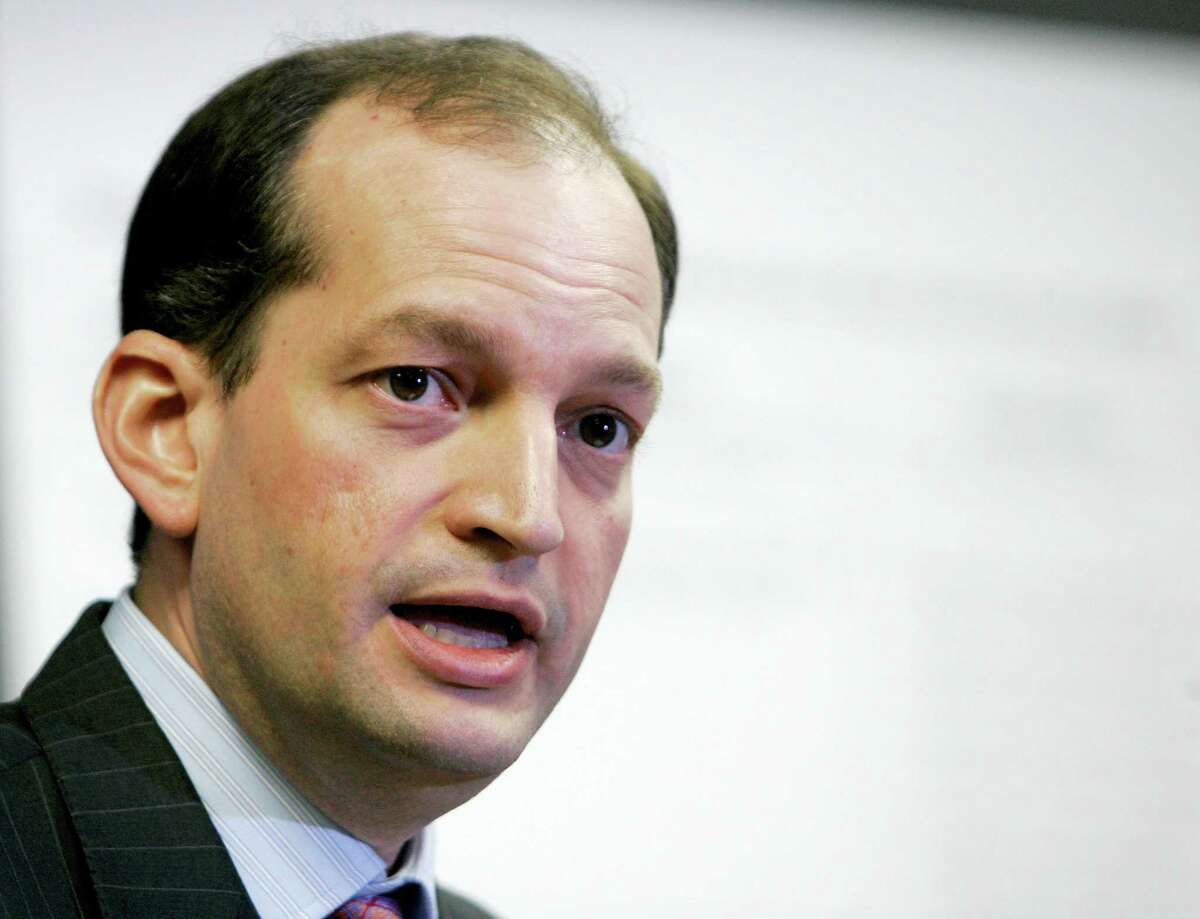 Alexander Acosta talks to reporters during a news conference in Miami in 2008. President Donald Trump says he's has chosen Acosta to be labor secretary.