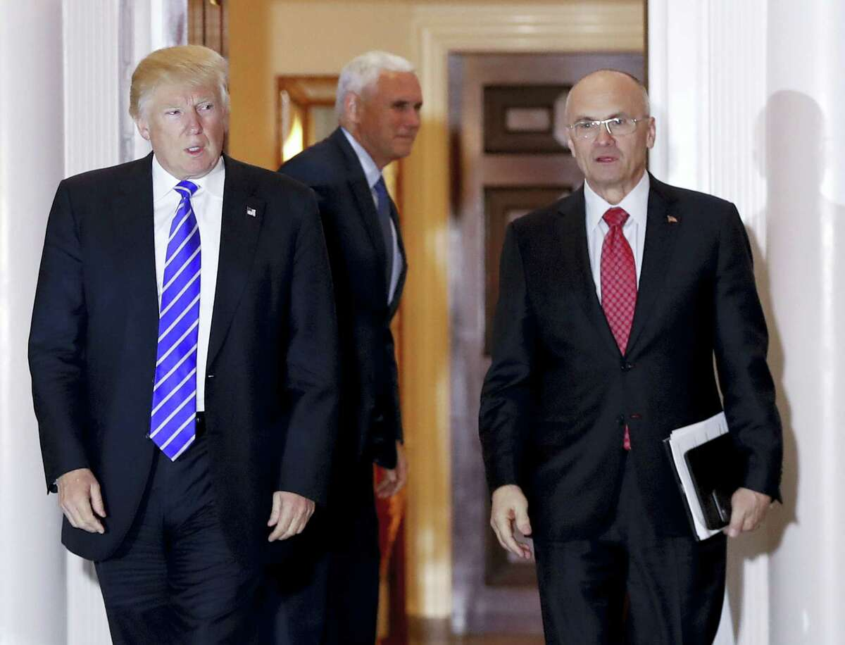 Then-President-elect Donald Trump walks then-Labor Secretary-designate Andrew Puzder from Trump National Golf Club Bedminster clubhouse in Bedminster, N.J. last November.