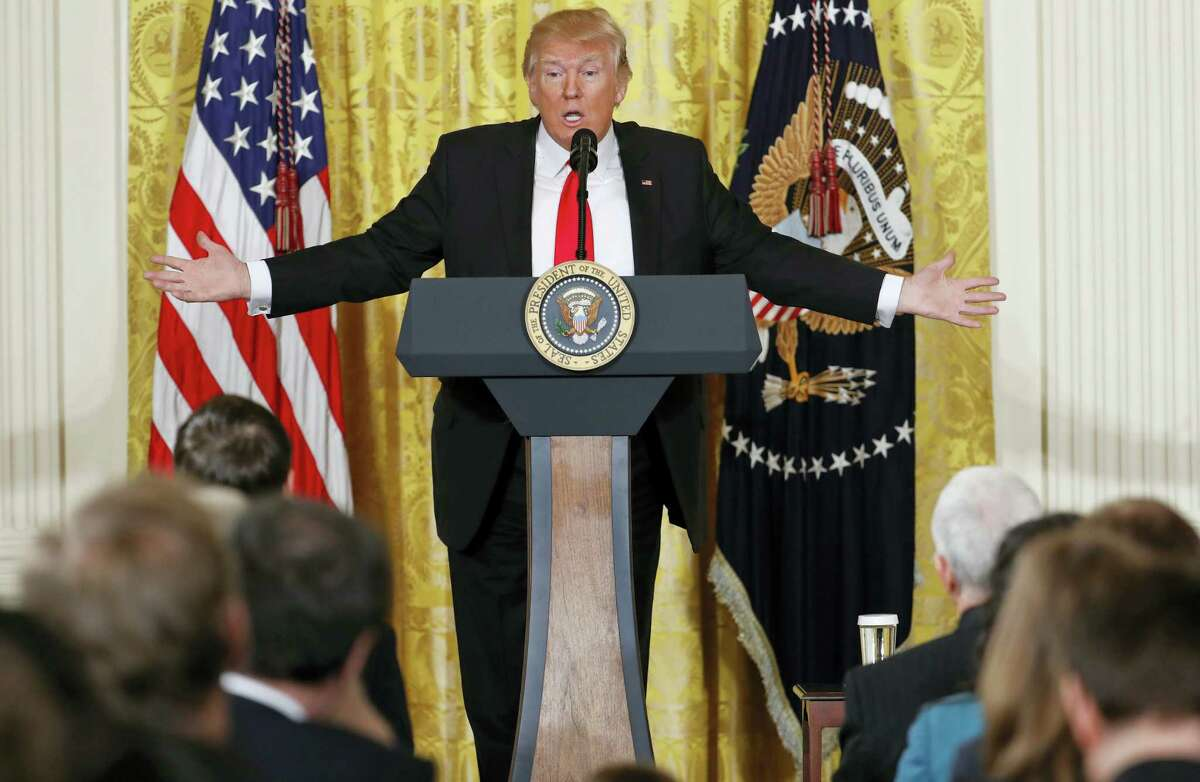 President Donald Trump speaks during a news conference in the East Room of the White House in Washington on Thursday.