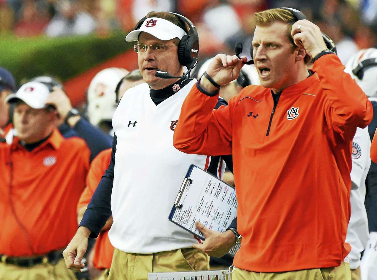 Former Auburn offensive coordinator Rhett Lashlee, right, is eager to get started helping to build the UConn program with coach Randy Edsall.