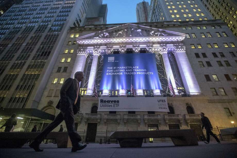 A pedestrian walks past the New York Stock Exchange, in lower Manhattan. Photo: Mary Altaffer — The Associated Press File   / Copyright 2016 The Associated Press. All rights reserved.