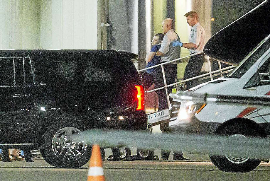 Otto Warmbier, a 22-year-old college student detained and imprisoned in North Korea, is carried off of an airplane at Lunken Airport in Cincinnati on Tuesday, June 13, 2017. Warmbier arrived in Ohio after being released by North Korea, where he was serving a 15-year prison term with hard labor for alleged anti-state acts. His parents have said he has been in a coma and was medically evacuated. Photo: Sam Greene/The Cincinnati Enquirer Via AP    / Cincinnati Enquirer ? 2017