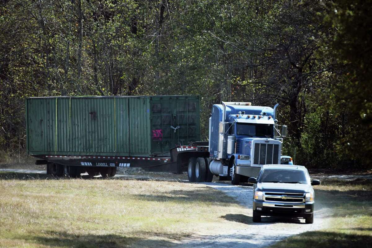 In this Wednesday, Nov. 9, 2016, file photo, the shipping container that an abducted woman was held in for two months is removed from Todd Kohlhepp's property in Woodruff, S.C. A South Carolina woman who spent two months chained inside a metal container says her captor bragged that he was good at killing people and warned her she could be next if she fought back or ran.
