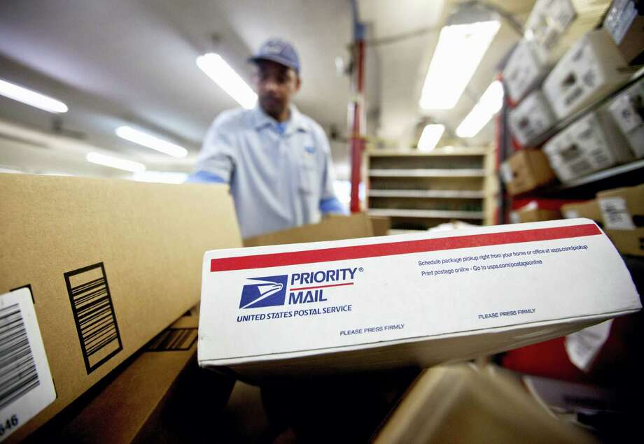 Packages wait to be sorted in a Post Office in Atlanta. Photo: David Goldman — The Associated Press FILE   / AP