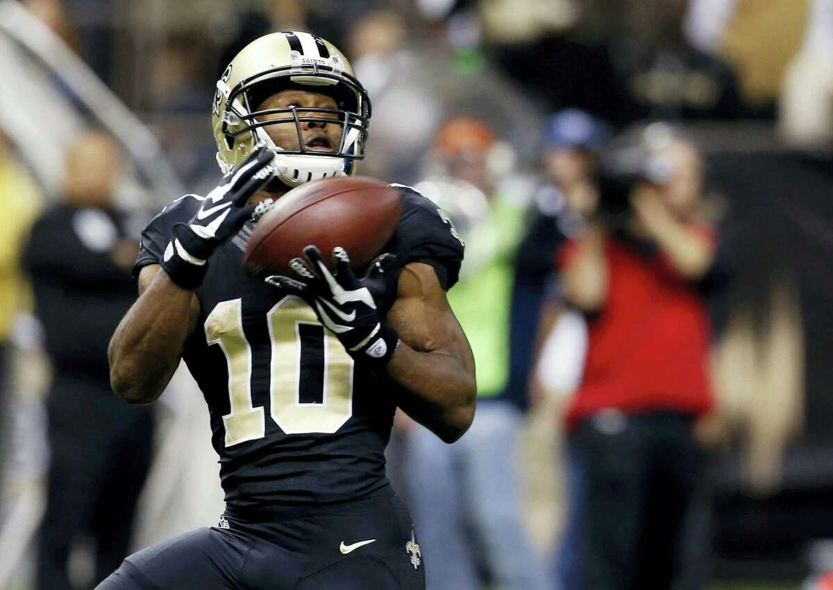 In this file photo, New Orleans Saints wide receiver Brandin Cooks (10) pulls in a touchdown pass against the Carolina Panthers in New Orleans. He's fresh off back-to-back 1,100-yard seasons as one of Drew Brees' favorite targets in the pass-friendly Saints offense. Now, following his trade from New Orleans to New England last week, those prospects could reach a new level as he prepares to catch passes from another surefire Hall of Famer, quarterback Tom Brady.