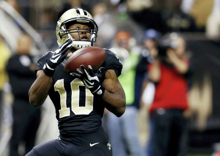 In this file photo, New Orleans Saints wide receiver Brandin Cooks (10) pulls in a touchdown pass against the Carolina Panthers in New Orleans.  He's fresh off back-to-back 1,100-yard seasons as one of Drew Brees' favorite targets in the pass-friendly Saints offense. Now, following his trade from New Orleans to New England last week, those prospects could reach a new level as he prepares to catch passes from another surefire Hall of Famer, quarterback Tom Brady. Photo: Jonathan Bachman — The Associated Press File   / FR170615 AP