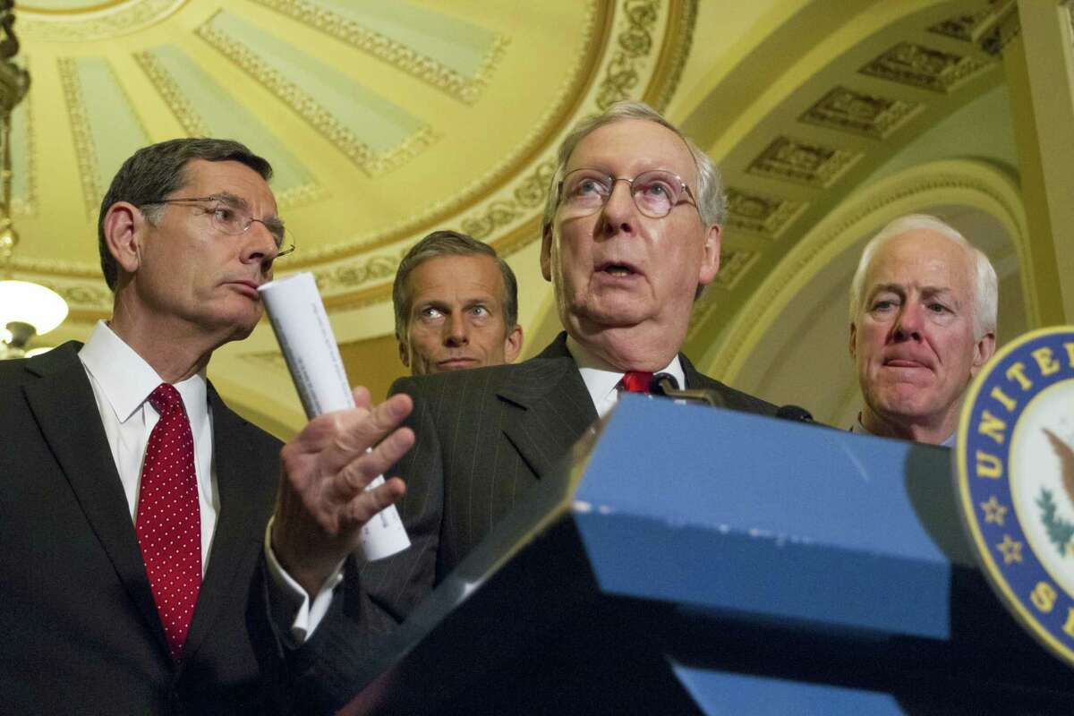Senate Majority Leader Mitch McConnell of Ky., center, joined by, from the left, Sen. John Barrasso, R-Wyo., Sen. John Thune, R-S.D., Senate Majority Whip John Cornyn of Texas, responds to reporters' questions on controversial statements by Republican presidential candidate Donald Trump, Tuesday, June 7, 2016, during a news conference on Capitol Hill in Washington following a closed-door policy meeting.