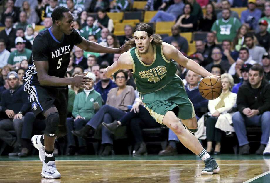 Boston Celtics center Kelly Olynyk (41) drives to the basket against Minnesota Timberwolves forward Gorgui Dieng (5) during the first quarter of an NBA game in Boston, Wednesday, March 15, 2017. (AP Photo/Charles Krupa) Photo: AP / Copyright 2017 The Associated Press. All rights reserved.