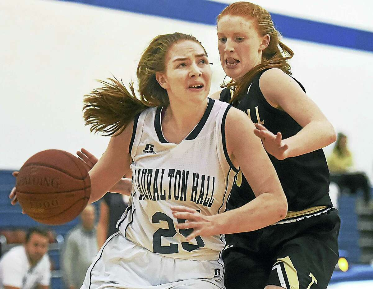 Trumbull junior Aisling Maguire pressures Lauralton Hall senior Trish Gildea (25) as she drives to the hoop in a 59 – 50 win for the visiting Eagles, Wednesday, January 25, 2017, at the Lauralton Hall Athletic Center in Milford.