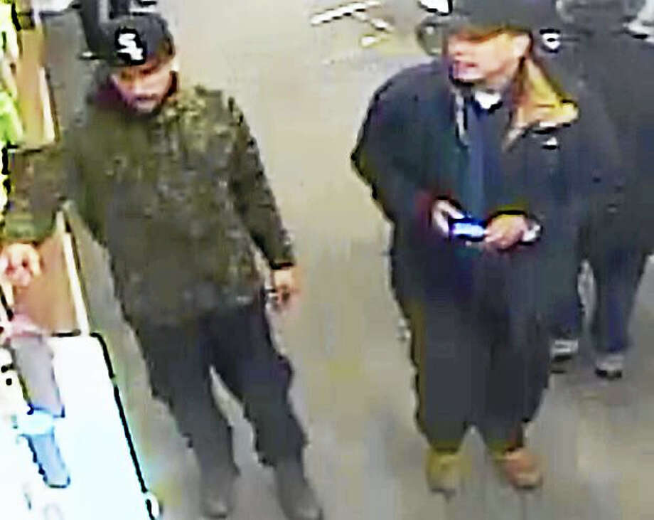 Police are asking the public to help them identify two men who allegedly stole hundreds of dollars' worth of equipment from a Hamden cellphone store Monday. Photo: Photo Courtesy Of The Hamden Police Department