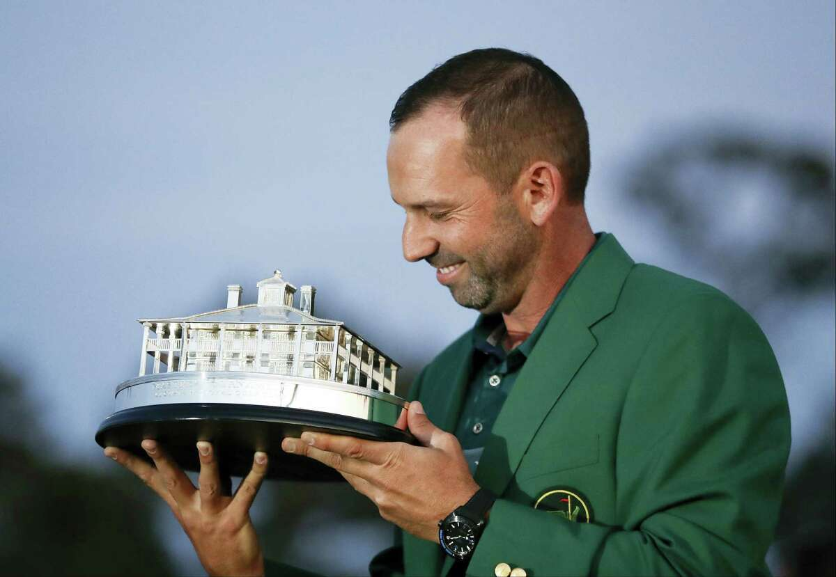 Sergio Garcia, of Spain, kisses his trophy at the green jacket ceremony after the Masters golf tournament Sunday in Augusta, Ga.