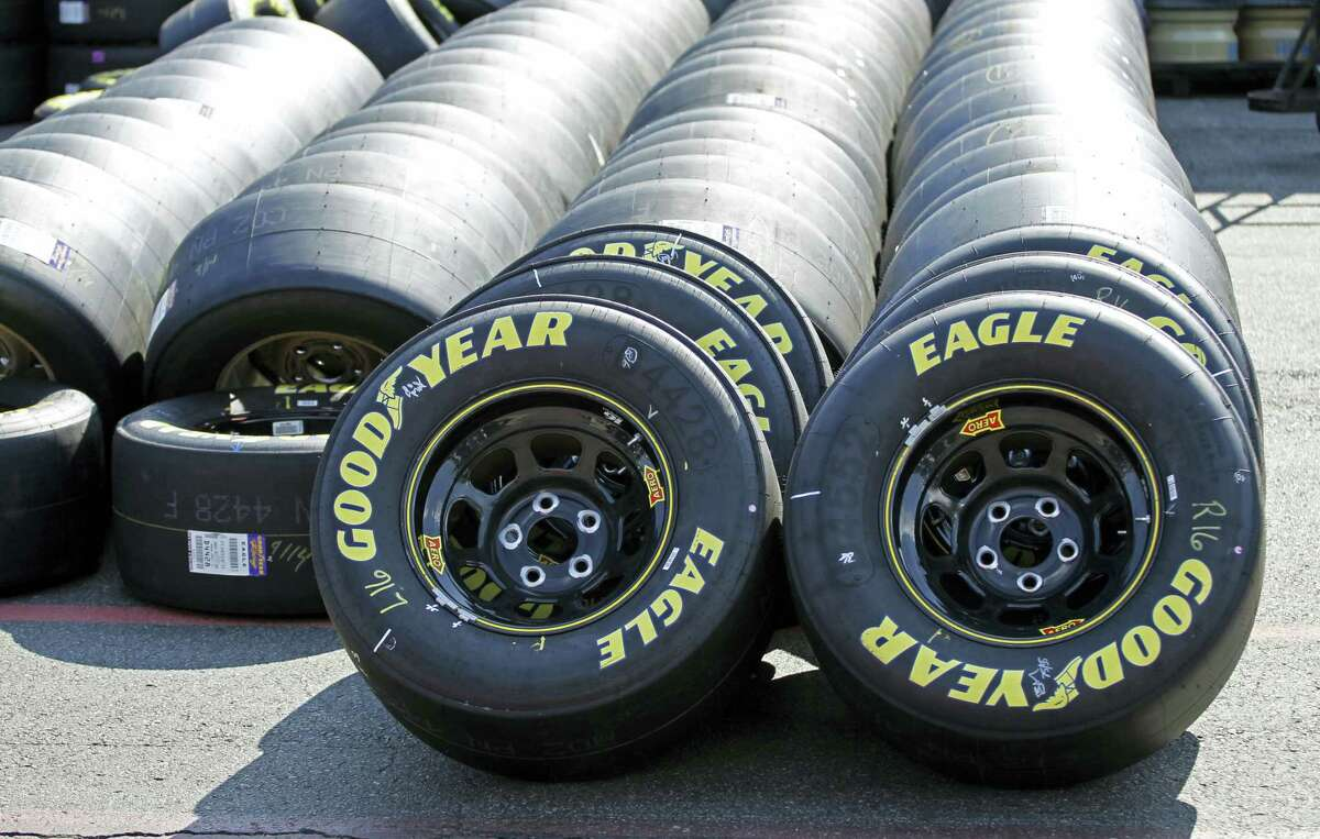 Goodyear racing tires are lined up in the garage during practice for a NASCAR Sprint Cup series race.