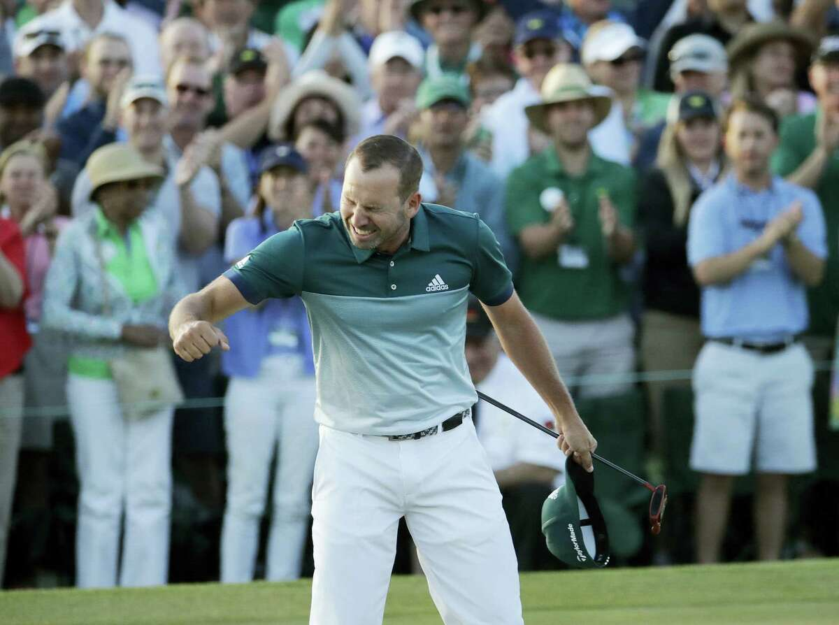 Sergio Garcia, of Spain, reacts after making his birdie putt on the 18th green to win the Masters golf tournament after a playoff Sunday in Augusta, Ga.