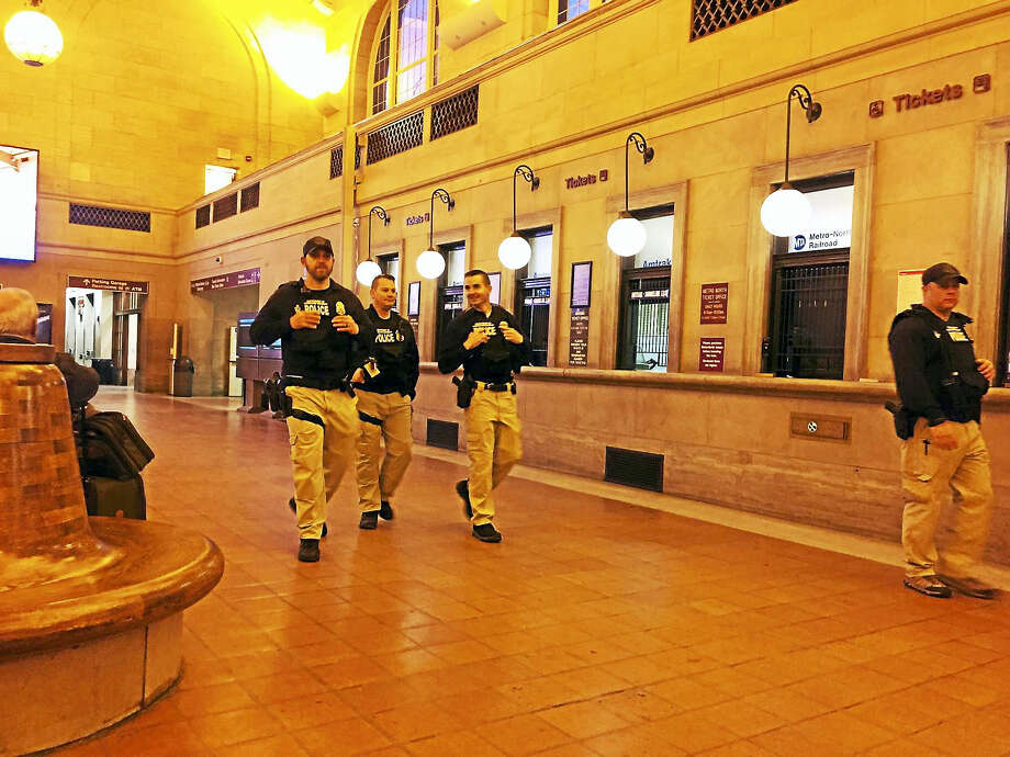Custom and Border Patrol agents at Union Station in New Haven Wednesday. Photo: Esteban L. Hernandez — New Haven Register