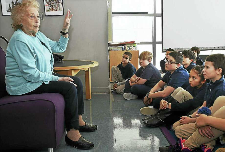 Holocaust survivor Hannah Kuperstoch of Hamden tells of her experience of living as a young Jewish girl in Poland during World War II to students at the John C. Daniels School of International Communication in New Haven Wednesday. Photo: Catherine Avalone — New Haven Register   / Catherine Avalone/New Haven Register