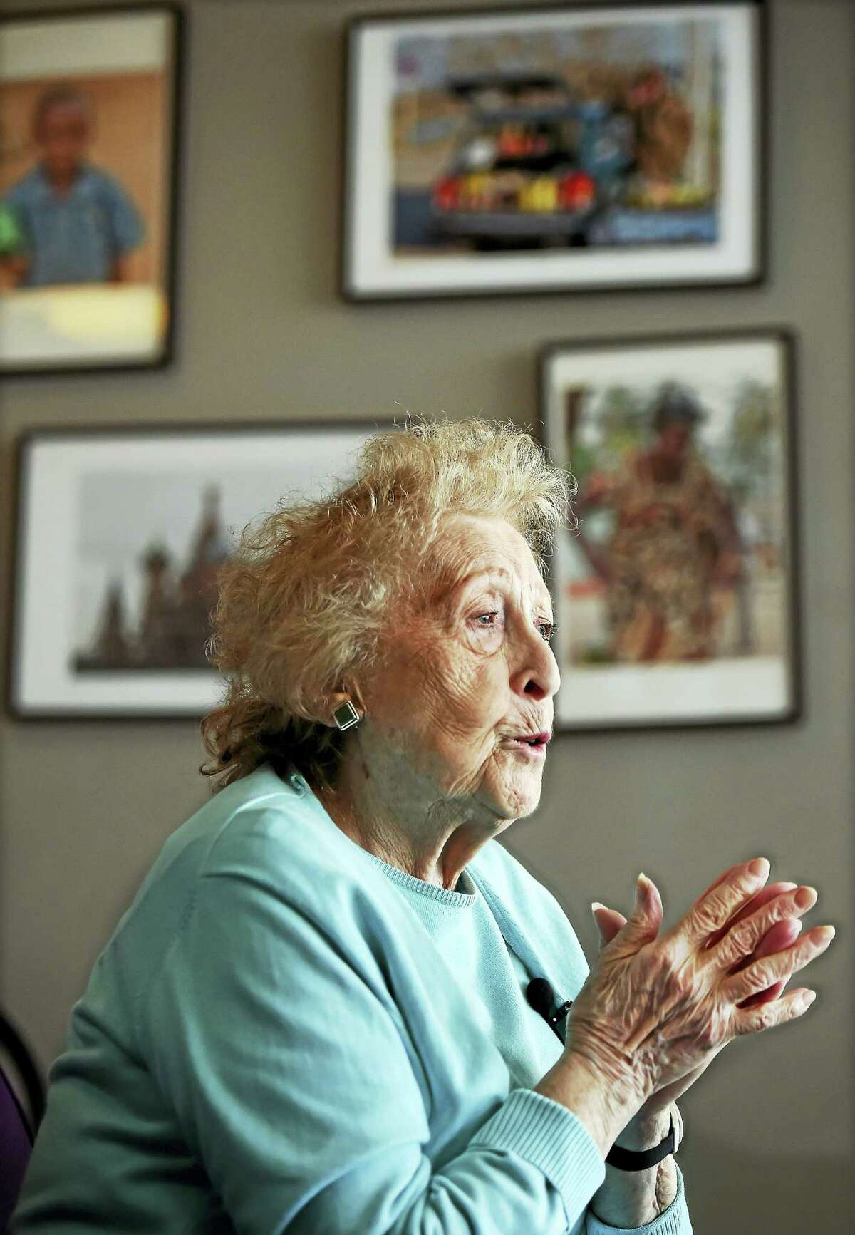Holocaust survivor Hannah Kuperstoch of Hamden tells of her experience of living as a young Jewish girl in Poland during World War II to students at the John C. Daniels School of International Communication in New Haven Wednesday.