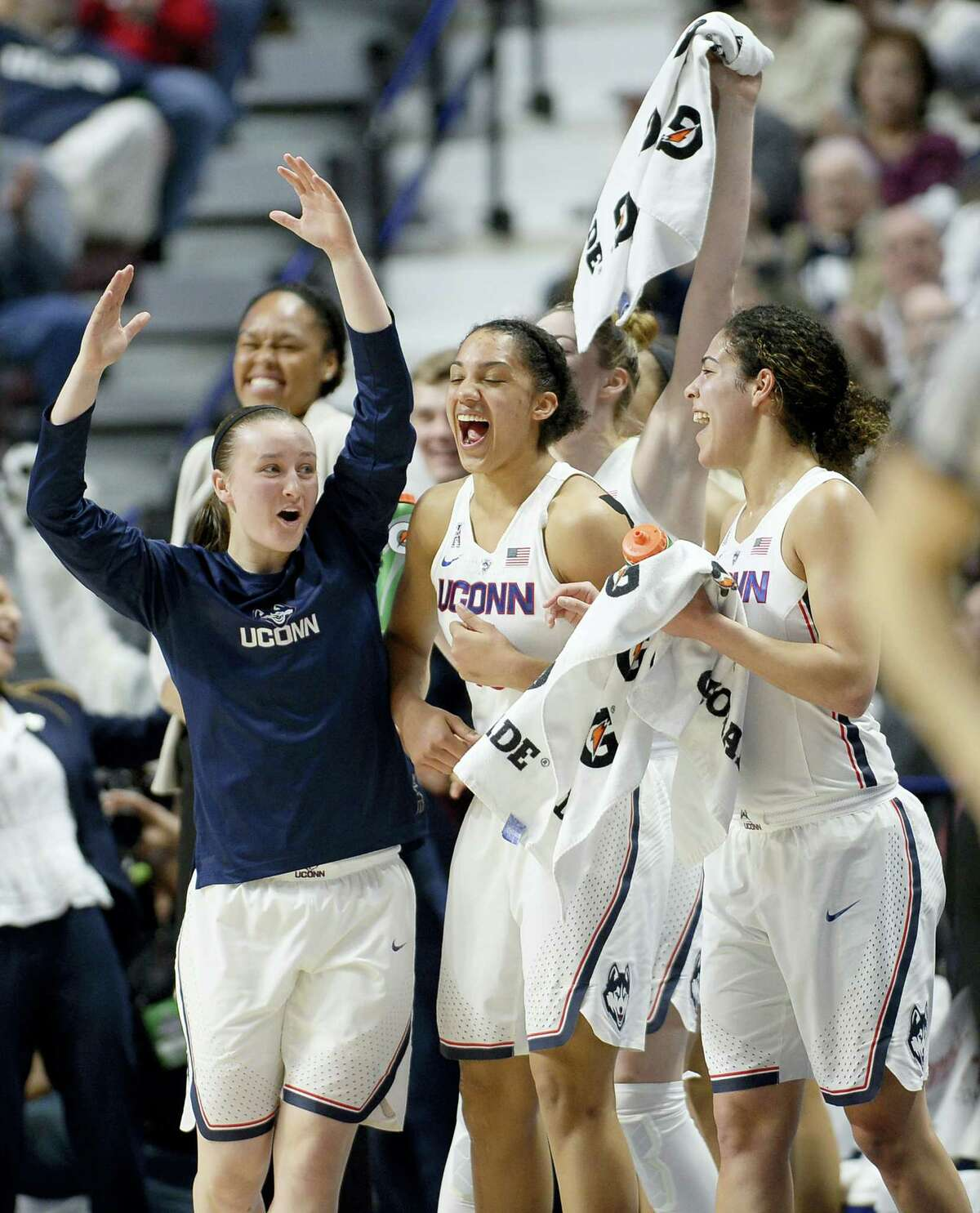 Connecticut's Tierney Lawlor, left, celebrates with Gabby Williams, center, and Kia Nurse, right, during the second half of an NCAA college basketball game against South Florida in the American Athletic Conference tournament finals at Mohegan Sun Arena on March 6, 2017 in Uncasville, Conn.