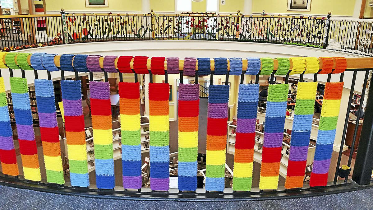 A yarn rainbow covers a bannister at Case Memorial Library.
