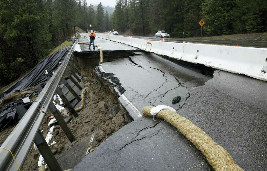 In this Feb. 21, 2017 photo, heavy storms over the past two weeks caused parts of the shoulder and one lane of westbound Highway 50 give way near Pollock Pines, Calif. The hole is about 40 feet long and 17 feet wide on one of the main routes to Lake Tahoe. Photo: AP Photo — Rich Pedroncelli   / Copyright 2017 The Associated Press. All rights reserved.