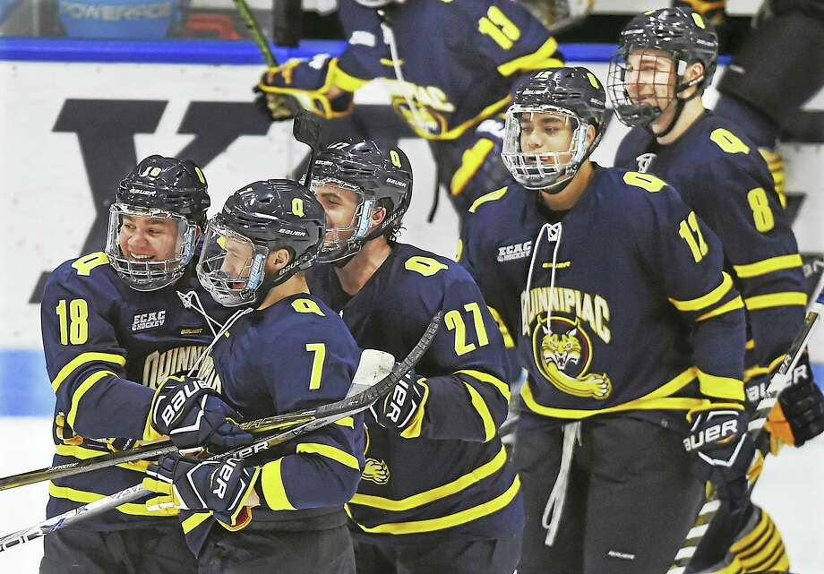 Quinnipiac's Nick Jermain (18) Logan Mick (7), Kevin McKernan (27), Thomas Aldworth (12) and Alex Whelan (8) celebrate a win over Yale in February. Photo: Catherine Avalone — Register File Photo   / Catherine Avalone/New Haven Register