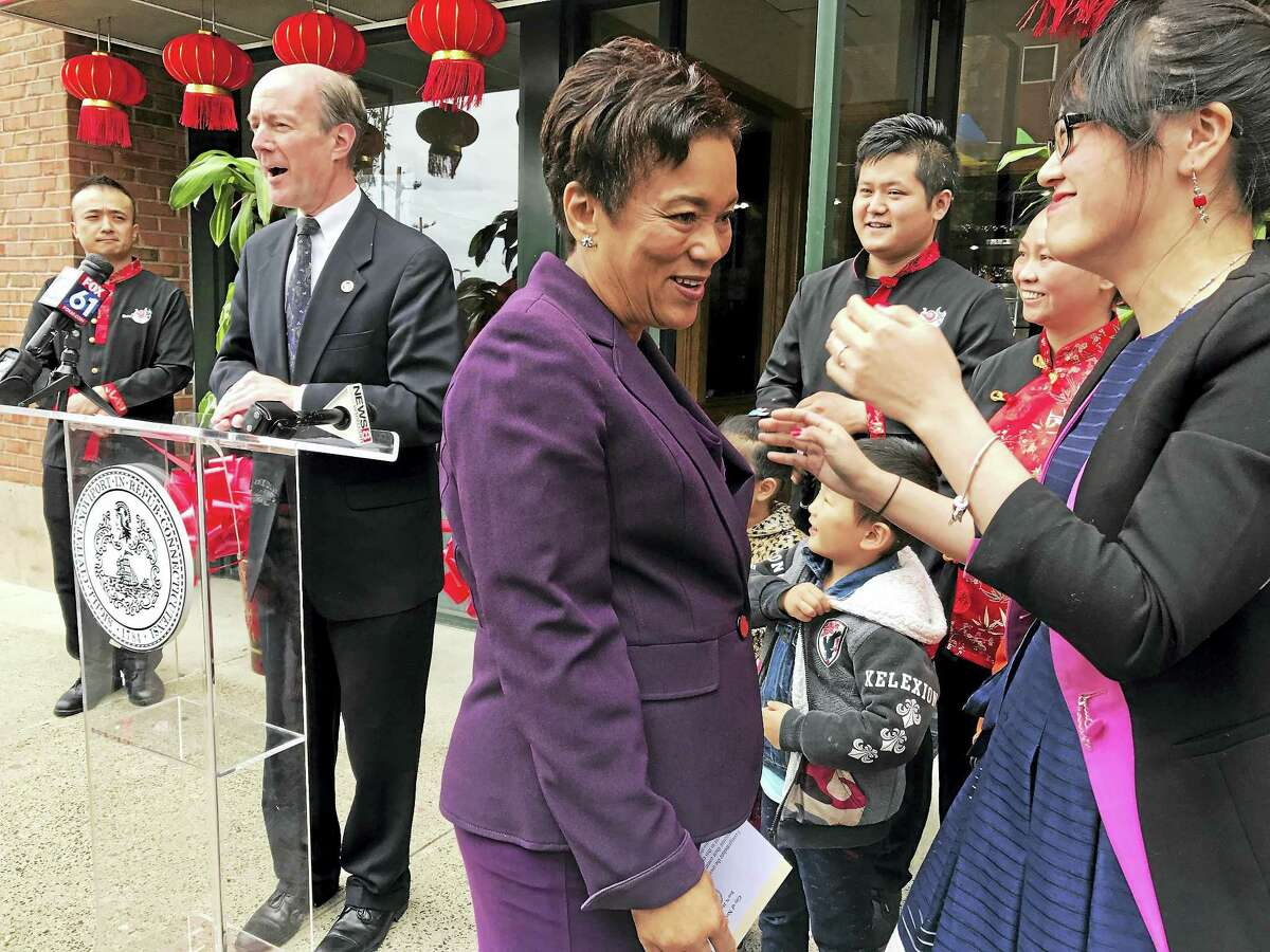 New Haven Mayor Toni Harp, center, before a press conference on Orange Street Monday in New Haven.