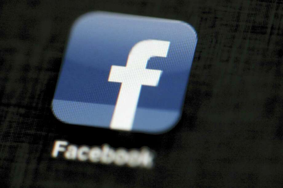 In this May 16, 2012, file photo, the Facebook logo is displayed on an iPad in Philadelphia. On Thursday, June 15, 2017, Facebook said it's using artificial intelligence to help it combat terrorists' use of its platform. The company's announcement comes as it faces growing pressure from government leaders to identify and prevent the spread of content from terrorist groups on its massive social network. Photo: Matt Rourke / AP Photo, File   / Copyright 2016 The Associated Press. All rights reserved. This material may not be published, broadcast, rewritten or redistribu
