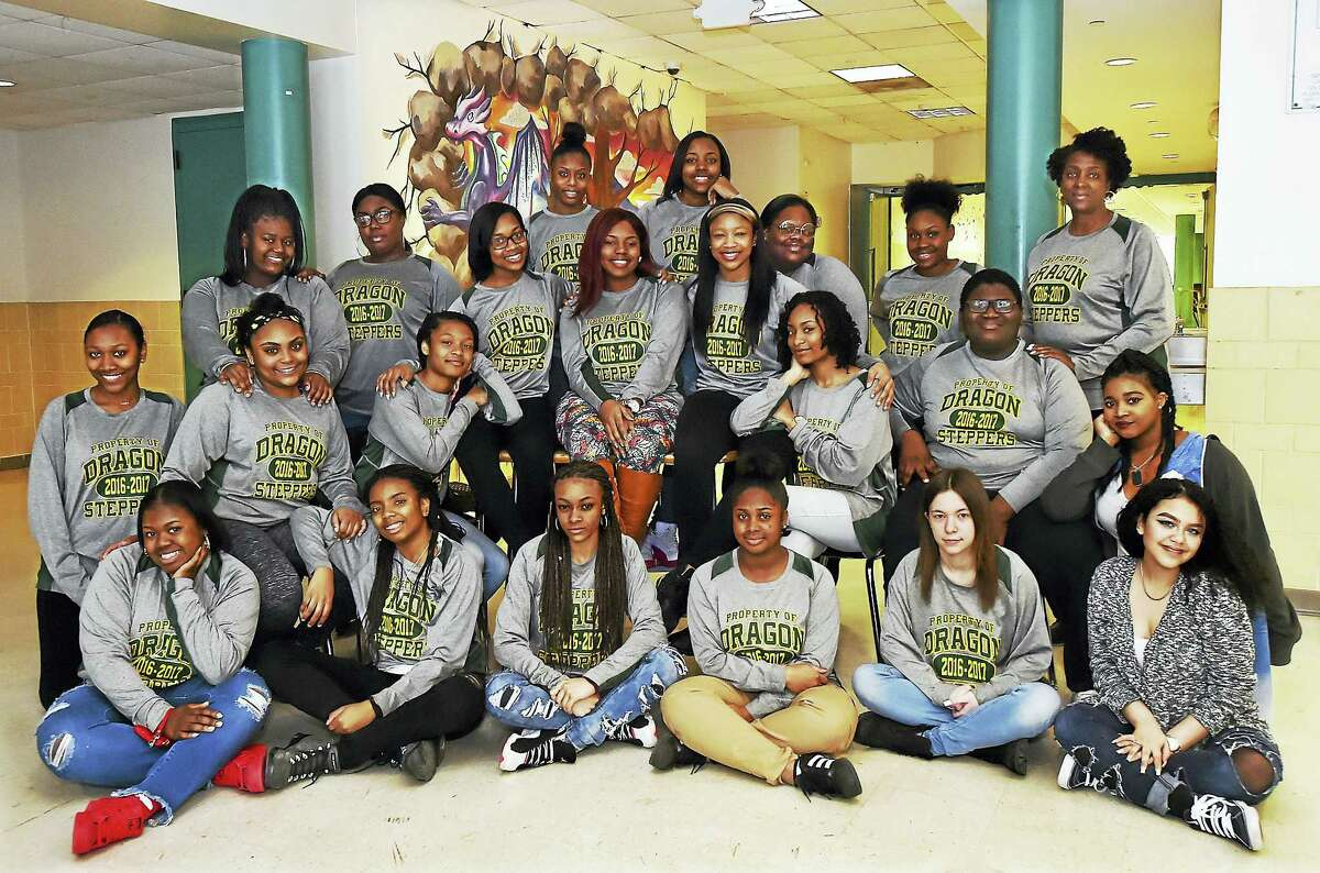 The Hamden Dragon Steppers are led by senior captain Bertlie Fleurimond, center, and junior co-captains Mahogany Carter, Jordan Evans, Asia Hannah and Sajdah Abdul-Karim with coach Barbara Mclain at Hamden High School recently.