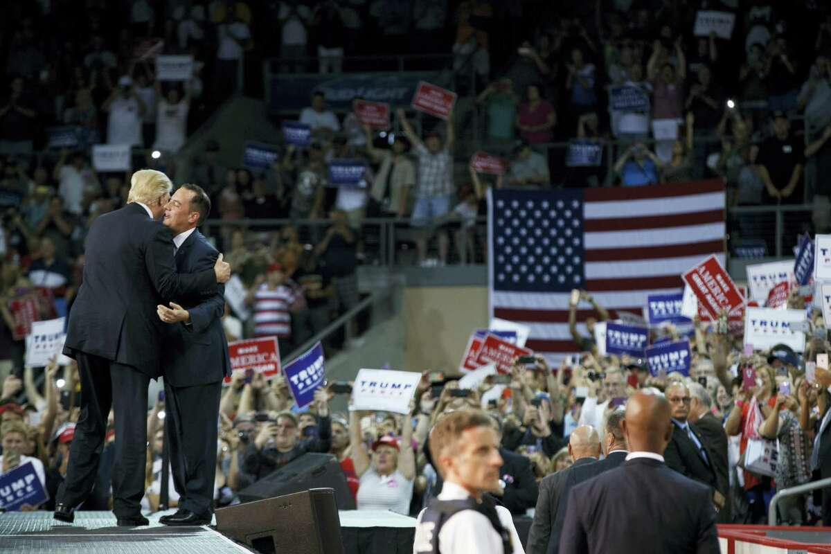 Republican National Committee (RNC) Chairman Reince Priebus greets Republican presidential candidate Donald Trump during a campaign rally in Erie, Pa.