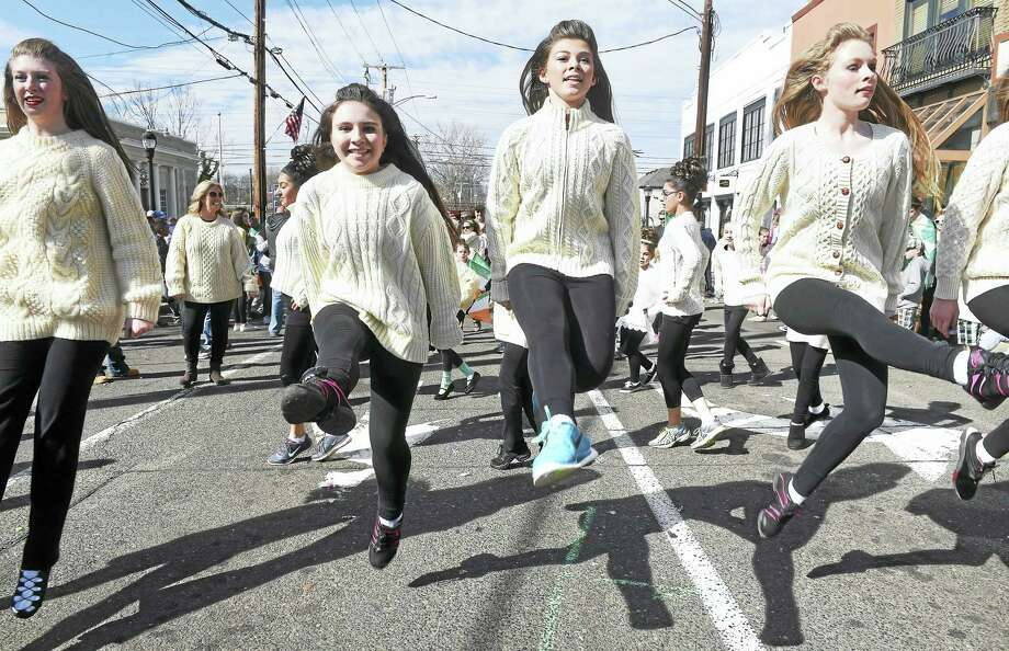 Members of the Lenihan School of Irish Dance get airborne at the Milford St. Patrick's Day Parade last year. Photo: Arnold Gold — Register File Photo