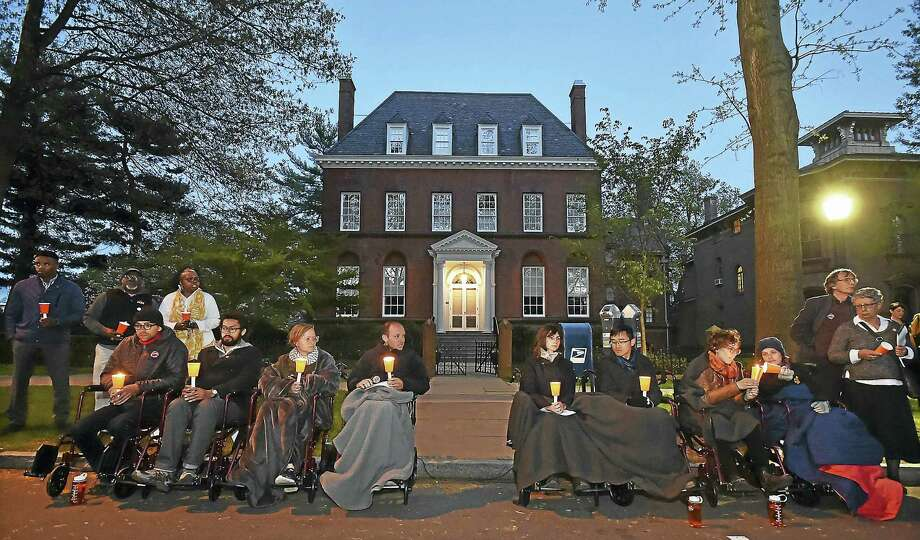 In this photo from early May, students and residents show their support for the Yale University graduate students who were then on a hunger strike at a candlelight vigil at the home of Yale University President Peter Salovey's home in New Haven Tuesday, Photo: Catherine Avalone — New Haven Register   / Catherine Avalone/New Haven Register